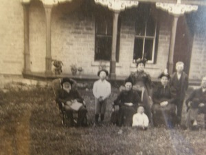 Carl Bonde, Sr. is the boy in the white shirt, standing in front of his childhood home near Nerstrand, Minnesota.