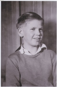 This photograph, taken by an unknown person, shows my uncle Carl --he was born in 1923, so perhaps 1932--in Kalispell.